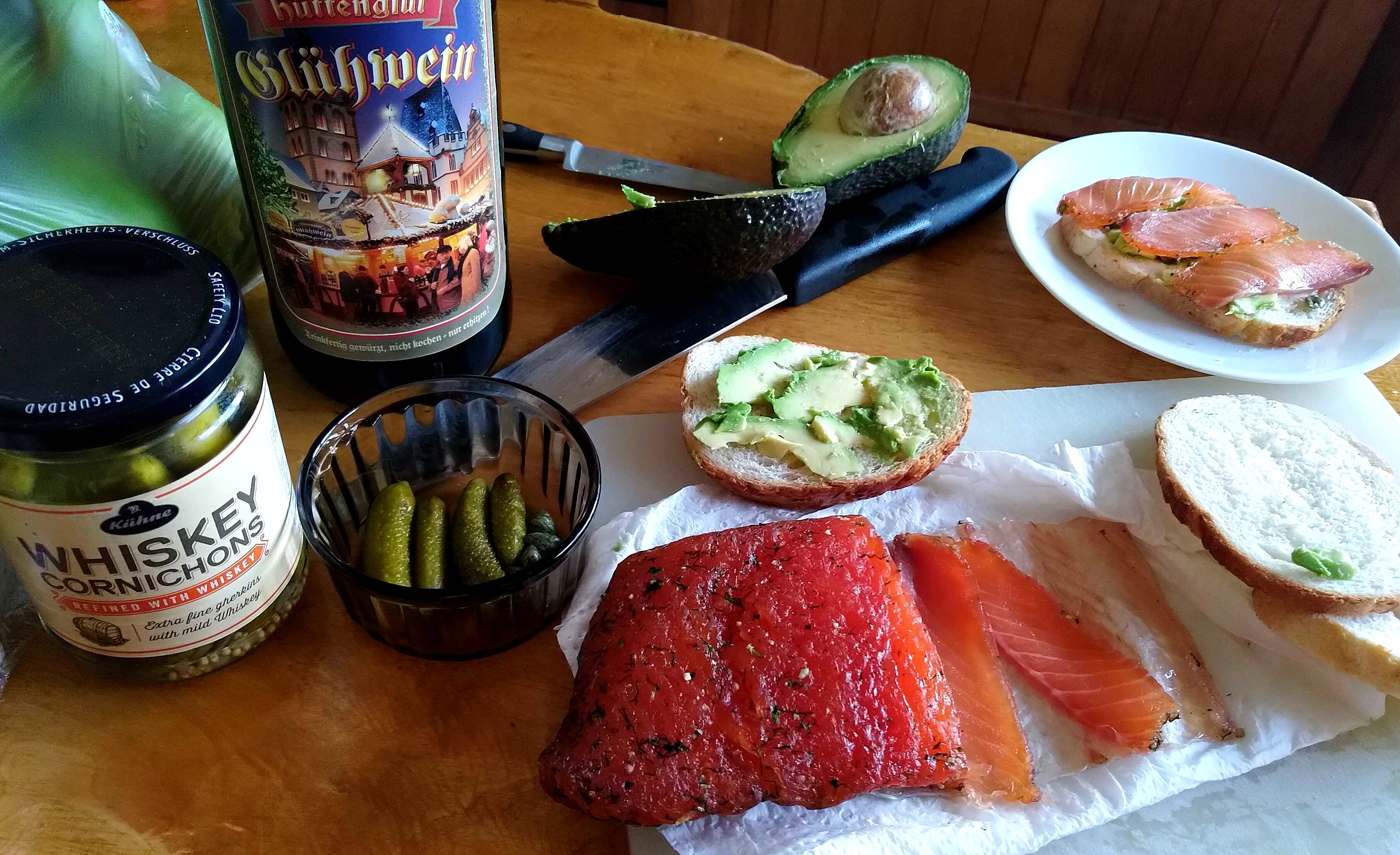Action shot!  Thinly-sliced salmon gravlax, whisky-cured pickled gherkins, avocado toast, and mulled wine.