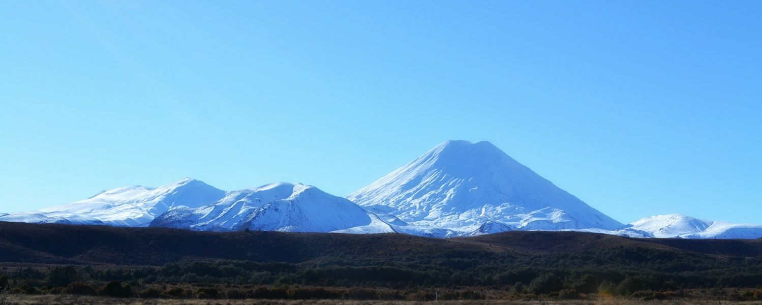 Landscape photography of Mount Tongariro and Mount Ngauruhoe, covered in white snow